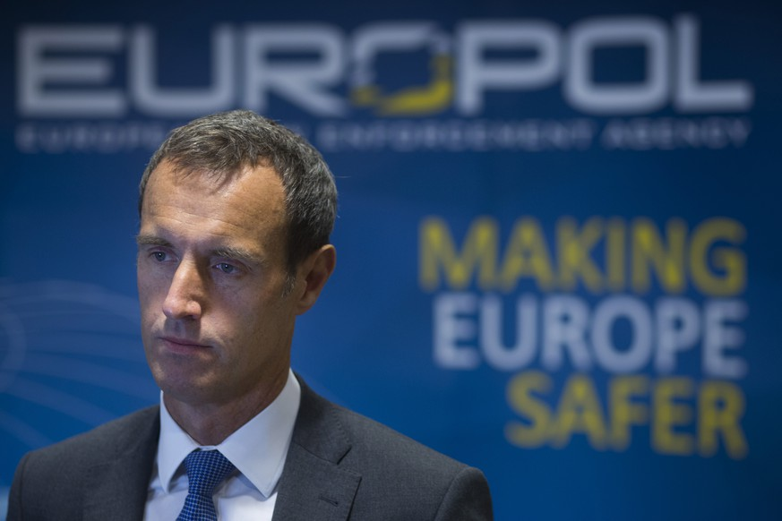 In this Friday Jan. 16, 2015 photo, the head of the European police agency Europol, Rob Wainwright, answers questions during an interview in The Hague, Netherlands. The European Union police agency has launched a new team to crack down on organized crime gangs that smuggle tens of thousands of illegal immigrants across the Mediterranean from North Africa to Europe.  (AP Photo/Peter Dejong)