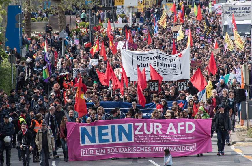 epa05284220 People hold banners reading 'No to the AfD' and 'Class war instead of division; as thousands of demonstrators take part in a protest in Stuttgart, Germany, 30 April 2016 against the right-wing conservative Alternative for Germany (AfD) who are holding their party national convention the city. Reports state that left wing protestors demonstrated outside the venue with the aim of stopping people attending the conference. German right-wing anti-migration Alternative for Germany (AfD) has recently come under criticism for remarks about the Islam.  EPA/DANIEL MAURER