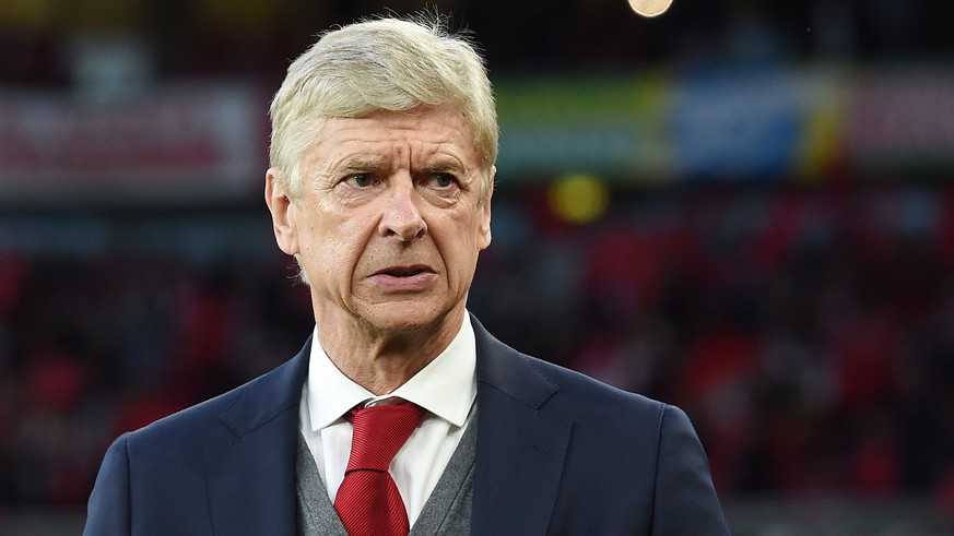 epa06698512 Arsenal manager Arsene Wenger ahead of his team's UEFA Europa League semi-final match with Atletico Madrid at the Emirates Stadium in London, Britain, 26 April 2018 (issued 28 April 2018).  Outgoing Arsenal boss Arsene Wenger has reportedly been given the chance to become the highest-paid manager in the world by managing in the Chinese Super League.  EPA/ANDY RAIN