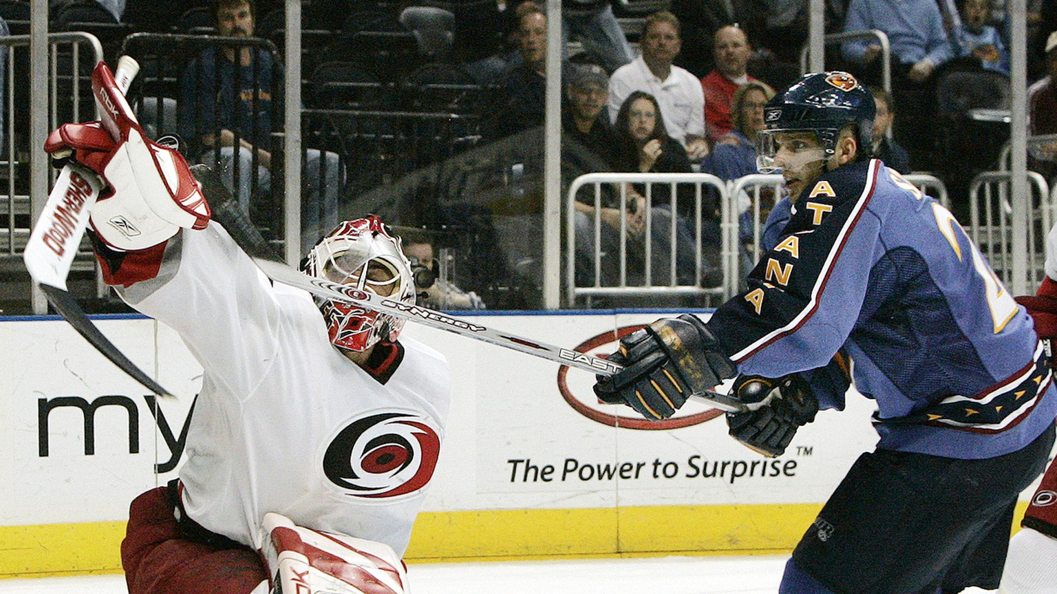 Atlanta Thrashers' Patrik Stefan, right, of the Czech Republic, reaches for the puck over Carolina Hurricanes goalie Martin Gerber, of Switzerland, in front of the goal during the first period of an NHL hockey game Saturday, April 8, 2006, in Atlanta. (AP Photo/John Bazemore)