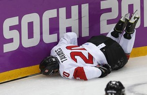 Canada's John Tavares lies on the ice after being injured while playing Latvia during the second period of their men's quarter-finals ice hockey game at the Sochi 2014 Winter Olympic Games February 19, 2014. REUTERS/Jim Young (RUSSIA  - Tags: SPORT ICE HOCKEY OLYMPICS)
