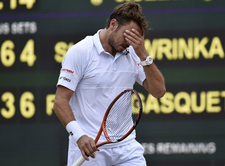 Stan Wawrinka of Switzerland reacts during his match against Richard Gasquet of France at the Wimbledon Tennis Championships in London, July 8, 2015.                            REUTERS/Toby Melville