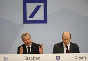 Deutsche Bank new Chief Executive John Cryan (R) and co-CEO Juergen Fitschen address a news conference in Frankfurt October 29, 2015. Deutsche Bank said it was reducing its workforce by 15,000 as Cryan seeks to improve returns at Germany's biggest bank. The lender said it would axe 9,000 full-time jobs and 6,000 external contractor positions.  REUTERS/Kai Pfaffenbach