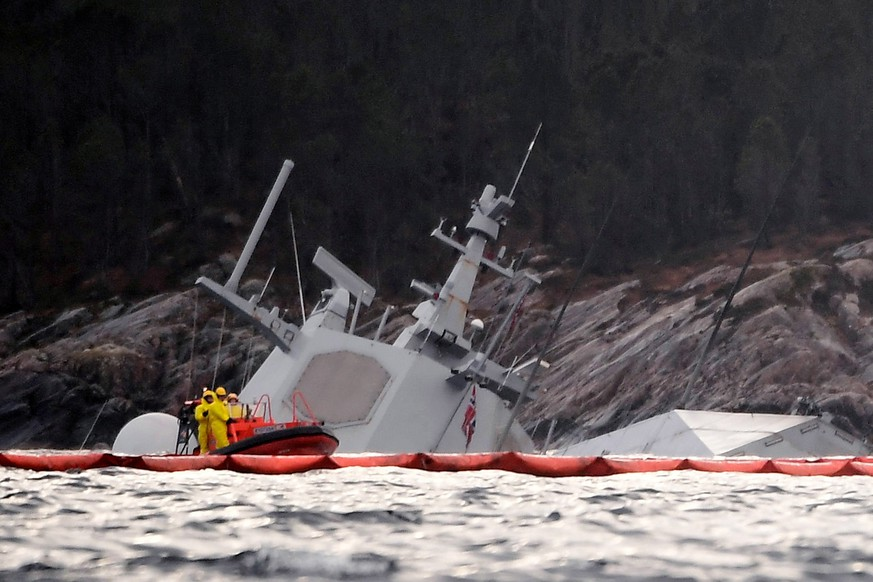 epa07162237 A view of the Norwegian frigate KNM Helge Ingstad partly under water in the sea near Bergen, western Norway, 13 November 2018. The frigate capsized after colliding with the tank ship Sola TS on 08 November 2018.  EPA/MARIT HOMMEDAL  NORWAY OUT