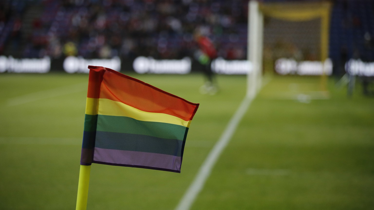 Rainbow flags hang from the corner post before the international friendly soccer match between Denmark and Germany at Brondby Stadion, Copenhagen, Tuesday, June 6, 2017. The Danish Football Association actively seeks to dissociate itself from any sexual bigotry in the sport. (Jens Dresling/Ritzau Foto via AP)