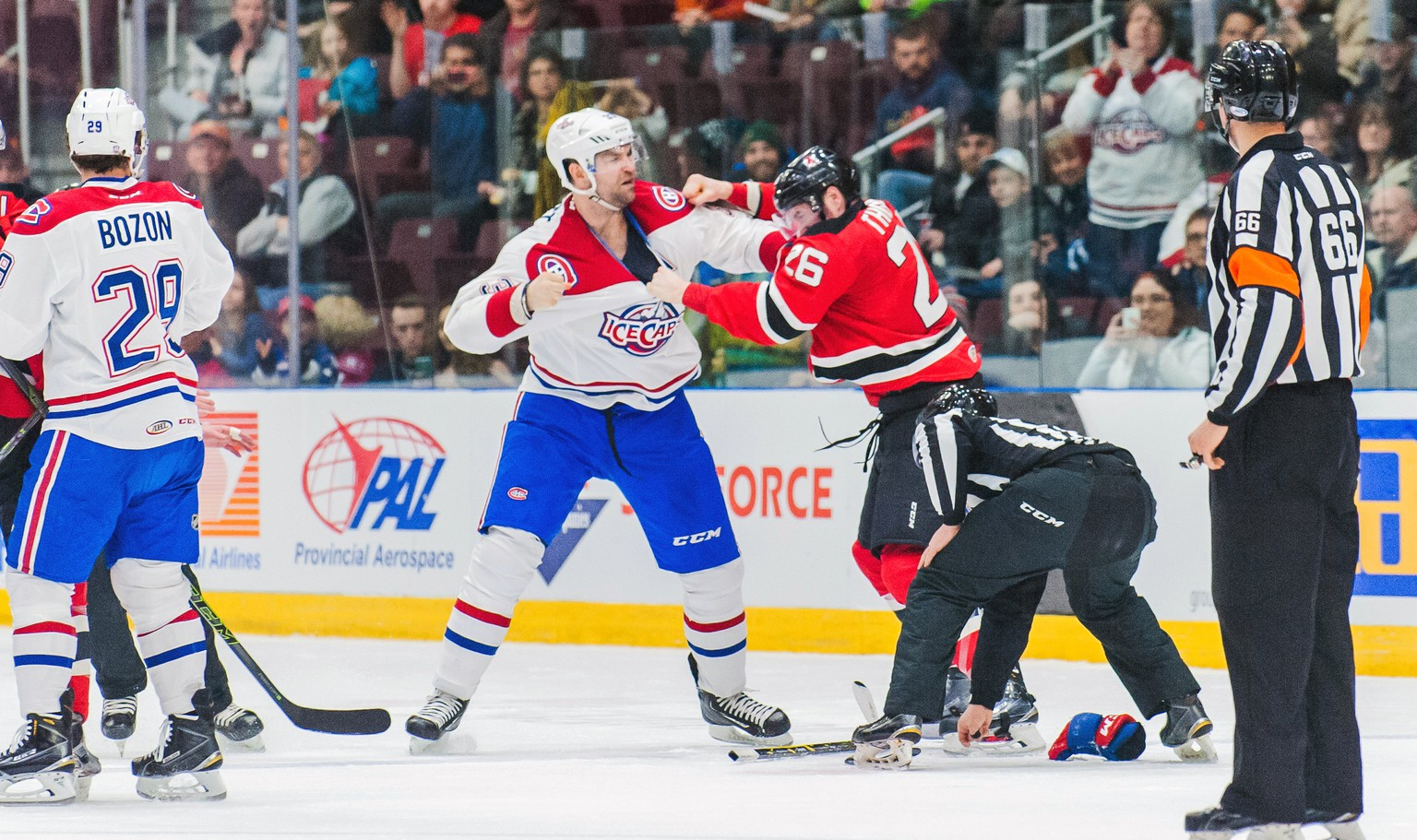 In this March 4, 2016 photo provided by the St. John's IceCaps, IceCaps player John Scott and Albany Devils' Ben Thomson fight during an AHL game in St. John's, Newfoundland.  The journeyman tough guy who won the hockey world over in becoming the NHL All-Star Game MVP is having a blast playing in the American Hockey League's eastern-most outpost. (Colin Peddle/St. John's IceCaps via AP)