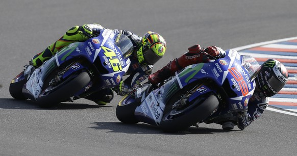 Italy's Valentino Rossi, left, rides his Yamaha behind Spain's Jorge Lorenzo with Yamaha during the MotoGP race of Argentina's Motorcycle Grand Prix at the Termas de Rio Hondo circuit in Argentina, Sunday, April 19, 2015. (AP Photo/Natacha Pisarenko)