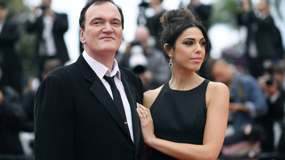 FILE - In this May 18, 2019 file photo, film director Quentin Tarantino and his wife Daniela Pick pose for photographers upon arrival at the premiere of the film
