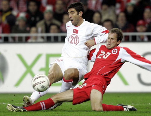 Turkey's Hakan Sukur, left, fights for the ball with Switzerland's Patrick Muller at the Stade de Suisse Wankdorf in Bern, Switzerland, Saturday, Nov. 12, 2005, during a World Cup 2006 qualifying play-off first leg soccer match. (KEYSTONE/AP Photo/Murad Sezer)
