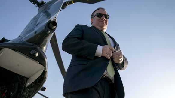 FILE - In this Monday, July 9, 2018 file photo, Secretary of State Mike Pompeo arrives at Camp Alvarado in Kabul, Afghanistan after meeting with Afghan President Ashraf Ghani. Pompeo used the unannounced trip to step up the Trump administration's calls for peace talks. The Taliban maintain the only talks they would take part in would be with the United States on their key demand: the withdrawal of all American forces from Afghanistan. (AP Photo/Andrew Harnik, Pool, File)