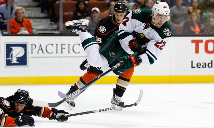 ANAHEIM, CA - OCTOBER 18:  Nino Niederreiter #22 of the Minnesota Wild leaves his skates as Kevin Bieksa #2 of the Anaheim Ducks and Ryan Getzlaf #15 of the Anaheim Ducks defend during the second period of a game at Honda Center on October 18, 2015 in Anaheim, California.  (Photo by Sean M. Haffey/Getty Images) *** BESTPIX ***