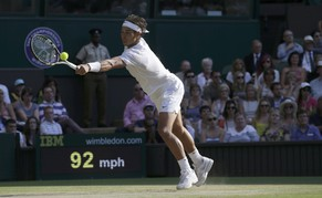 Rafael Nadal of Spain hits a return during his men's singles tennis match against Nick Kyrgios of Australia at the Wimbledon Tennis Championships, in London July 1, 2014.            REUTERS/Max Rossi (BRITAIN  - Tags: SPORT TENNIS)
