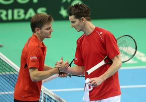 epa04654202 Belgium's David Goffin (L) after his won his match against Swiss Michael Lammer (R) during the Davis Cup World Group First Round tie between Belgium and Switzerland at the Country Hall in Liege, Belgium, 08 March 2015.  EPA/JULIEN WARNAND