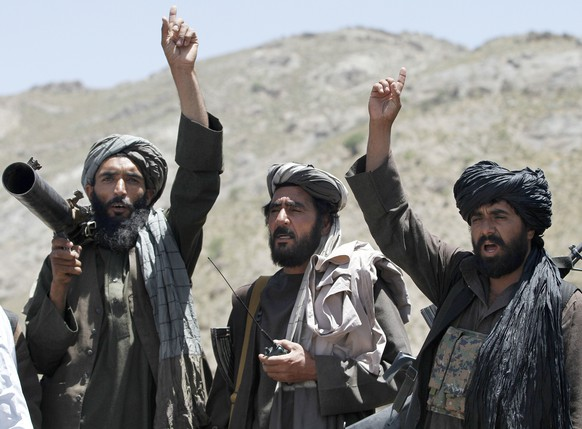 FILE - In this May 27, 2016  file photo, Taliban fighters react to a speech by a senior leader of a breakaway faction of the Taliban, Mullah Abdul Manan Niazi, in the Shindand district of Herat province, Afghanistan. Taliban officials say the extremist group has appointed Maulvi Ibrahim Sadar as a new military chief as the insurgents try to gain ground rather than talk peace under a new leadership. Sadar's appointment coincides with an uptick in Taliban attacks against Afghanistan's security forces. (AP Photos/Allauddin Khan, File)