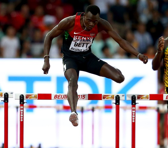 BEIJING, CHINA - AUGUST 23:  (L-R) Michael Tinsley of the United States, Nicholas Bett of Kenya and Leford Green of Jamaica compete in the Men's 400 metres hurdles semi-final during day two of the 15th IAAF World Athletics Championships Beijing 2015 at Beijing National Stadium on August 23, 2015 in Beijing, China.  (Photo by Cameron Spencer/Getty Images)