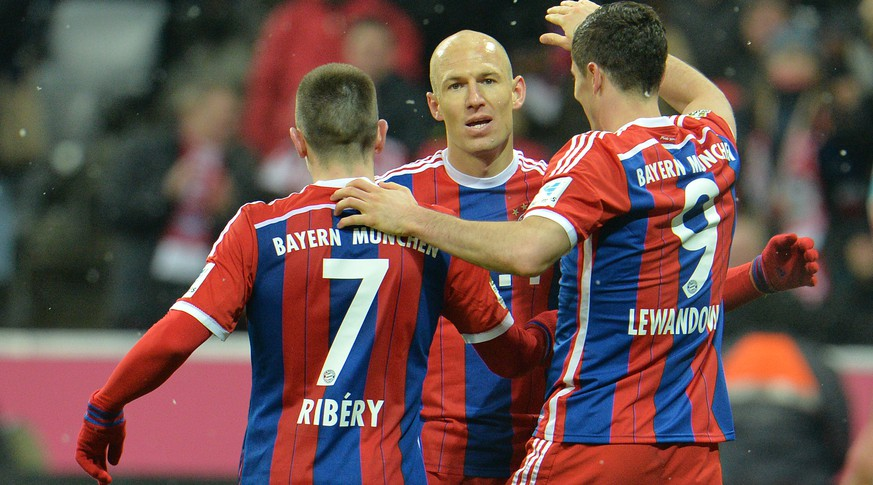 Bayern's Franck Ribery from France, Arjen Robben from the Netherlands and scorer Robert Lewandowski from Poland, from left, celebrate after scoring during the  soccer match between FC Bayern Munich and 1. FC Cologne in the Allianz Arena in Munich, Germany, Friday, Feb. 27, 2015. (AP Photo/Kerstin Joensson)