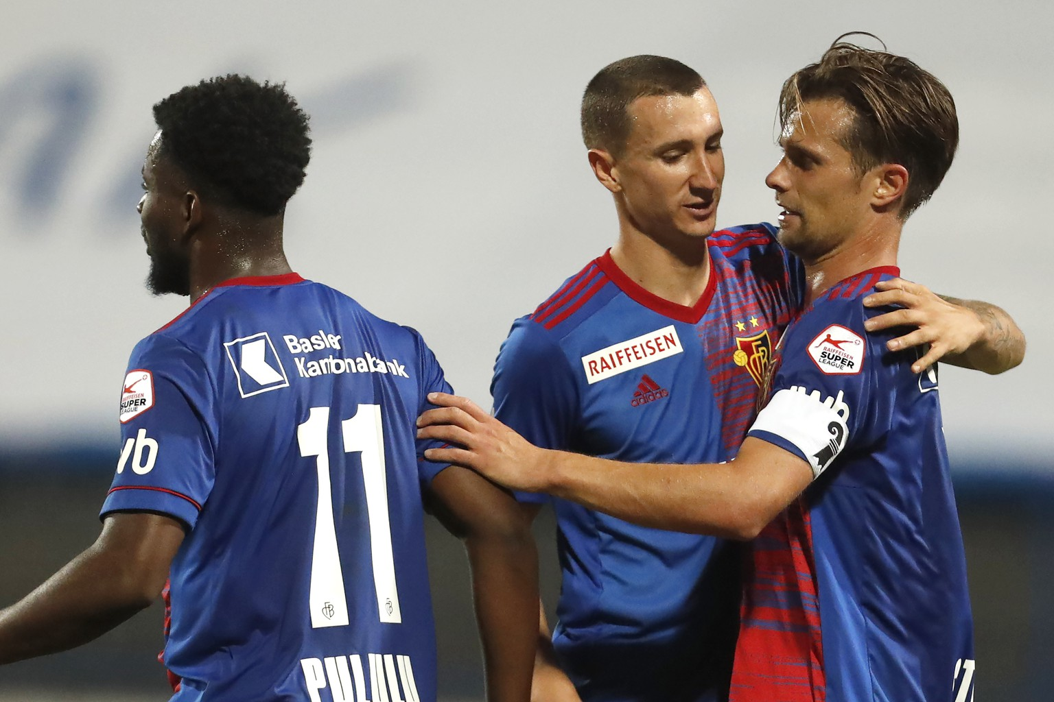 Basel's Valentin Stocker, right, celebrates with his teammate his goal against Osijek during the Europa League second qualifying round soccer match between Osijek and Basel at the Gradski Vrt stadium in Osijek, Croatia, Thursday, Sept. 17, 2020. (AP Photo/Darko Bandic)
