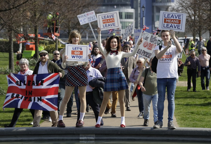 Pro-Brexit leave the European Union supporters pose for photos as they take part in the final leg of the