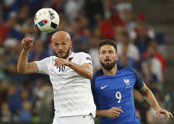 Football Soccer - France v Albania - EURO 2016 - Group A - Stade Vélodrome, Marseille, France - 15/6/16 Albania's Arlind Ajeti in action with France's Olivier Giroud  REUTERS/Yves Herman Livepic