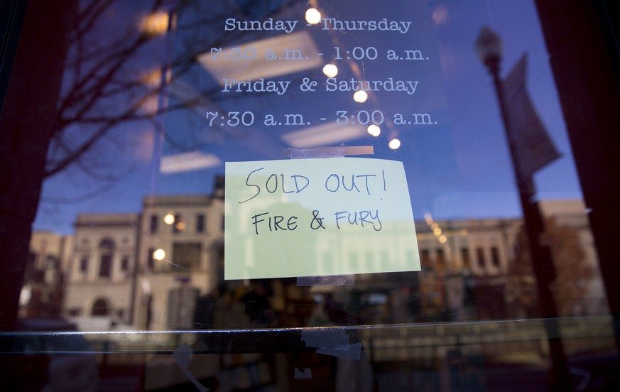 Sign posted at the door for Kramerbooks & Afterwords Cafe indicating that the book