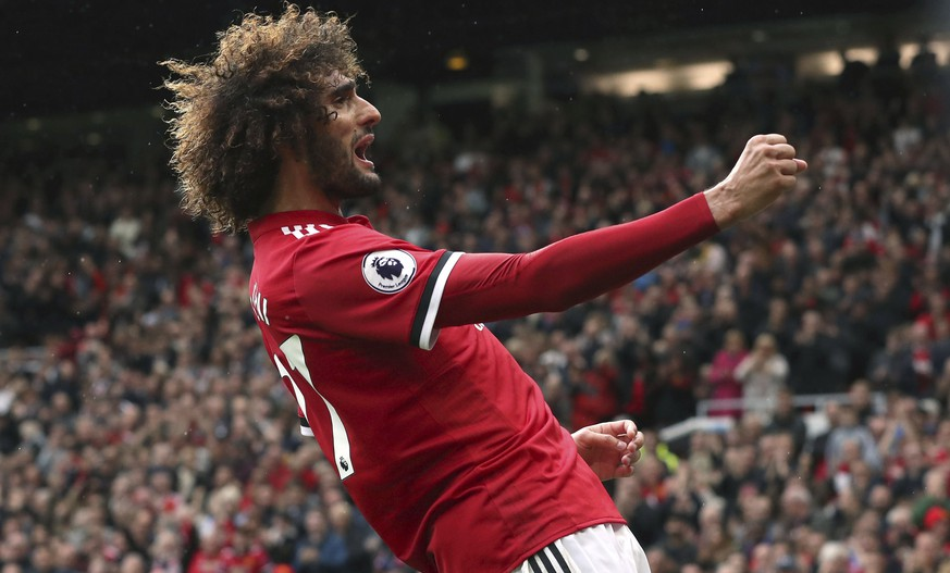Manchester United's Marouane Fellaini celebrates scoring his side's second goal of the game during the English Premier League soccer match between Manchester United and Crystal Palace at Old Trafford, Manchester, England. Saturday, Sept. 30, 2017. (Martin Rickett/PA via AP)