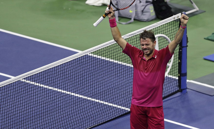 Stan Wawrinka, of Switzerland, raises his arms after defeating Juan Martin del Potro, of Argentina, during the quarterfinals at the U.S. Open tennis tournament, early Thursday, Sept. 8, 2016, in New York. Wawrinka won 7-6 (5), 4-6, 6-3, 6-2. (AP Photo/Charles Krupa)
