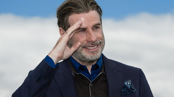 epa06738667 US actor John Travolta poses during a photocall for at the 71st annual Cannes Film Festival, in Cannes, France, 15 May 2018.  EPA/CLEMENS BILAN