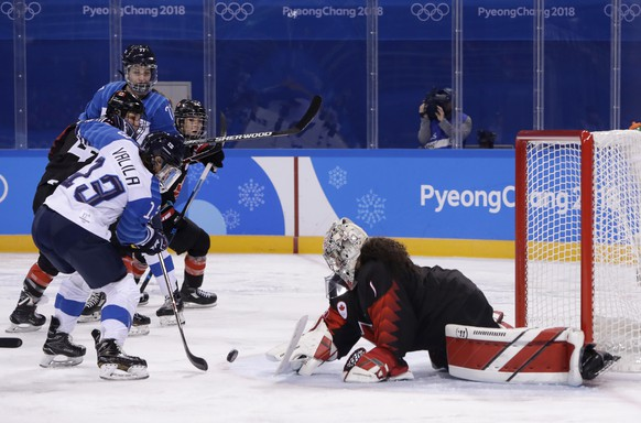 Riikka Valila, of Finland, scores a goal against goalie Shannon Szabados (1), of Canada, during the third period of the preliminary round of the women's hockey game at the 2018 Winter Olympics in Gangneung, South Korea, Tuesday, Feb. 13, 2018. (AP Photo/Matt Slocum)