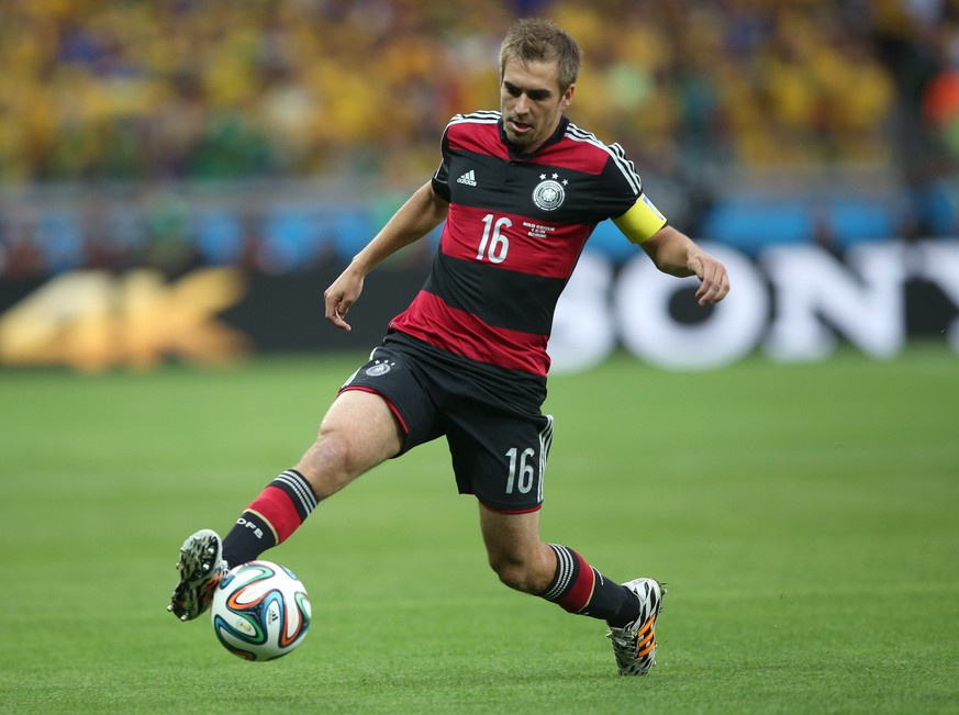 epa04320629 (FILE) A file picture dated 08 July 2014 shows Philipp Lahm of Germany in action during the FIFA World Cup 2014 semi final match between Brazil and Germany at the Estadio Mineirao in Belo Horizonte, Brazil. A confirmation on 18 July 2014 states that Germany's World Cup winning captain Philipp Lahm is to retire from the national team. Lahm began his Germany career in February 2004 with a 2-1 win away to Croatia. He went on to win 113 caps for his country and scored five goals, most notably in the opening game of the 2006 World Cup against Costa Rica.
