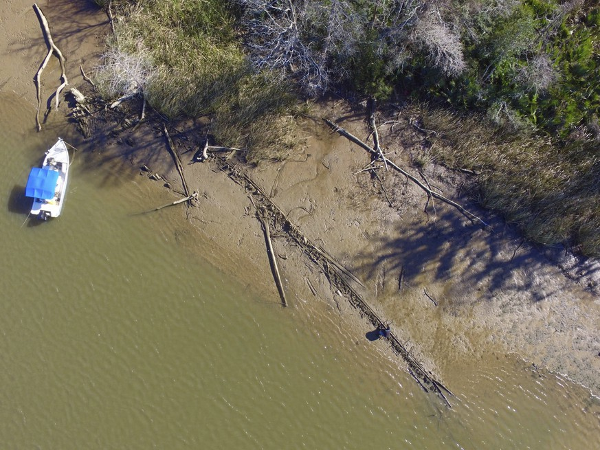 This aerial photo taken Tuesday, Jan. 2, 2018, in Mobile County, Ala., shows the remains of a ship that could be the Clotilda, the last slave ship documented to have delivered captive Africans to the United States. The Clotilda was burned after docking in Mobile, Ala., in 1860, long after the importation of humans was banned, and experts say the remains found by a reporter from Al.com could be what is left of the long-lost wreck. (Ben Raines/Al.com via AP)