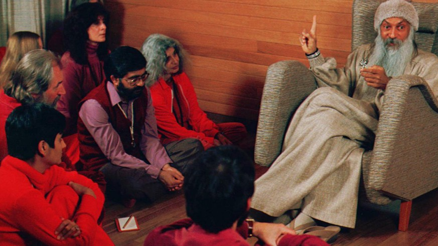 Bhagwan Shree Rajneesh, right, speaks with his disciples in this undated photo in Rajneeshpuram, Ore. Patrons of 10 restaurants in The Dalles, Ore., became ill in Sept. 1984, after being poisoned by members of the fringe religious cult who sprayed lab-cultured salmonella bacteria onto salad bars over a two-week period. (AP Photo/Jack Smith)