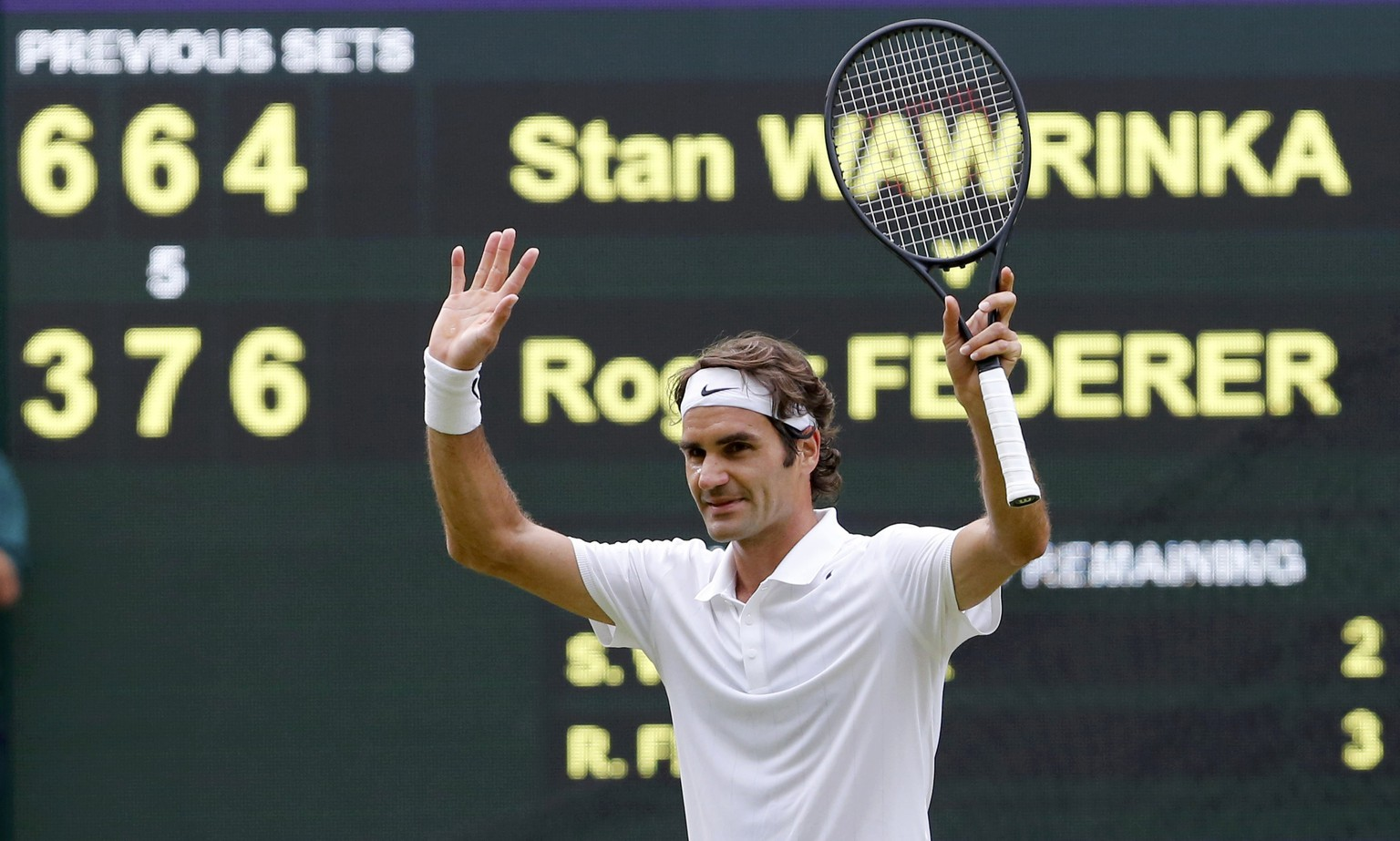 Roger Federer of Switzerland reacts after defeating Stanislas Wawrinka of Switzerland in their men's singles quarter-final tennis match at the Wimbledon Tennis Championships, in London July 2, 2014.            REUTERS/Suzanne Plunkett (BRITAIN  - Tags: SPORT TENNIS TPX IMAGES OF THE DAY)