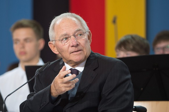 epa04812320 German Finance Minister Schaeuble speaks at the awarding of the Point Alpha Prize, Geisa, Germany 21 June 2015. The Point Alpha Prize comprises of 25,000 euros and is named after the former US observation post Point Alpha at the former inner-German border diving the two Germanies.  EPA/SEBASTIAN KAHNERT