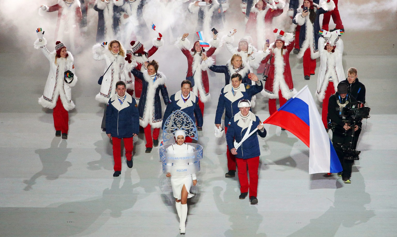epa05303428 (FILE) A file picture dated 07 February 2014 of Team Russia with flag bearer Alexander Zubkov (R) during the Opening Ceremony of the Sochi 2014 Olympic Games at the Fisht Olympic Stadium in Sochi, Russia. The International Olympic Committee (IOC) on 13 May 2016 called for immediate investigations on allegations of Russian state-sponsored doping at the Sochi 2014 Olympic Games. Grigory Rodchenkov, former head of Russia's anti-doping laboratory, admitted that banned performance-enhancing substances have been supplied and urine samples have been exchanged before and during the Sochi 2014 Olympics, the New York Times reported on 12 May 2016.  EPA/BARBARA WALTON *** Local Caption *** 51215598