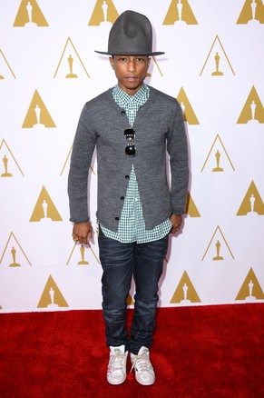 Pharrell Williams arrives at the 86th Oscars Nominees Luncheon, on Monday, Feb. 10, 2014 in Beverly Hills, Calif. (Photo by Jordan Strauss/Invision/AP)