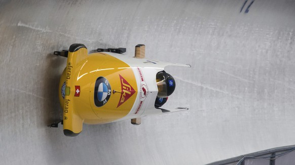 The Swiss bobsleigh team with Sabina Hafner and brakewoman Eveline Rebsamen  speed down the track during the 2nd two-women run of the Bob and Skeleton World Championship 2017 in Schoenau am Koenigssee, Germany, Friday, Feb. 17, 2017.  (Peter Kneffel/dpa via AP)