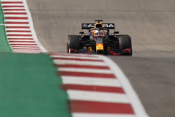 Red Bull driver Max Verstappen, of the Netherlands, steers into a turn during the qualifying session for the Formula One U.S. Grand Prix auto race at the Circuit of the Americas, Saturday, Oct. 23, 2021, in Austin, Texas. (AP Photo/Eric Gay) Max Verstappen