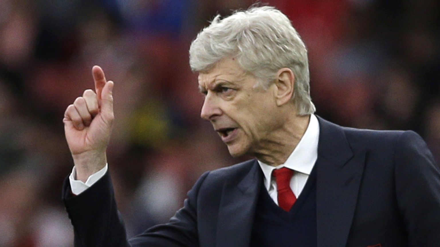 FILE - In this  Sunday, April 2, 2017 file photo, Arsenal team manager Arsene Wenger gestures during the English Premier League soccer match between Arsenal and Manchester City at the Emirates stadium in London. With Arsenal in danger of failing to qualify for the Champions League for the first time in 21 years, manager Arsene Wenger says his sixth-placed team faces a