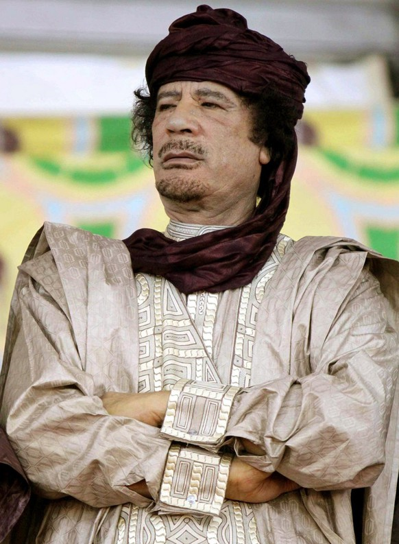 epa03728250 (FILE) A file photograph dated 06 October 2009, shows Muammar al-Gaddafi, leader of Libya, at the 50th anniversary of the founding of the officers group that mounted the Libyan Revolution and the continuation of the 40th anniversary celebrations of the revolution itself in Sebha, Libya. Media reports on 02 June 2013 state that South African officials are investigating claims that ex-Libyan leader Muammar Gaddafi and his family have hidden 701 million euros or 1 billion US dollars of assets in the country.  EPA/SABRI ELMEHDWI *** Local Caption *** 50085120