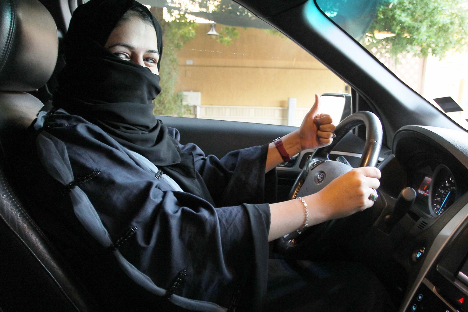 epa06230465 A woman gives a thumb up as she sits behind the wheel of a car in Riyadh, Saudi Arabia, 27 September 2017. According to reports on 26 September 2017, Saudi Arabia's King Salman bin Abdulaziz Al Saud has issued a decree that will allow women to drive and which is to be implemented by June 2018. Saudi Arabia was the world's only country where women were not allowed to drive.  EPA/STR