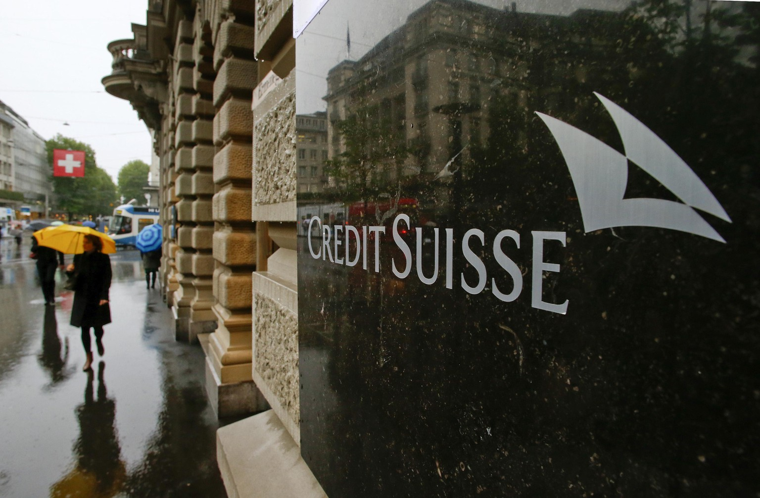 Swiss bank Credit Suisse logo is seen in front of its headquarters in Zurich May 2, 2014. Switzerland's finance minister Eveline Widmer-Schlumpf was set to meet Eric Holder, the U.S. attorney general, in Washington on Friday to discuss a tax-evasion probe into Swiss banks by U.S. authorities, a Swiss ministry spokesman said. U.S. prosecutors have been pushing for Credit Suisse, the biggest Swiss bank in the probe, to plead guilty as part of a resolution of the investigation, a person familiar with the matter said.      REUTERS/Arnd Wiegmann (SWITZERLAND - Tags: POLITICS BUSINESS CRIME LAW LOGO)
