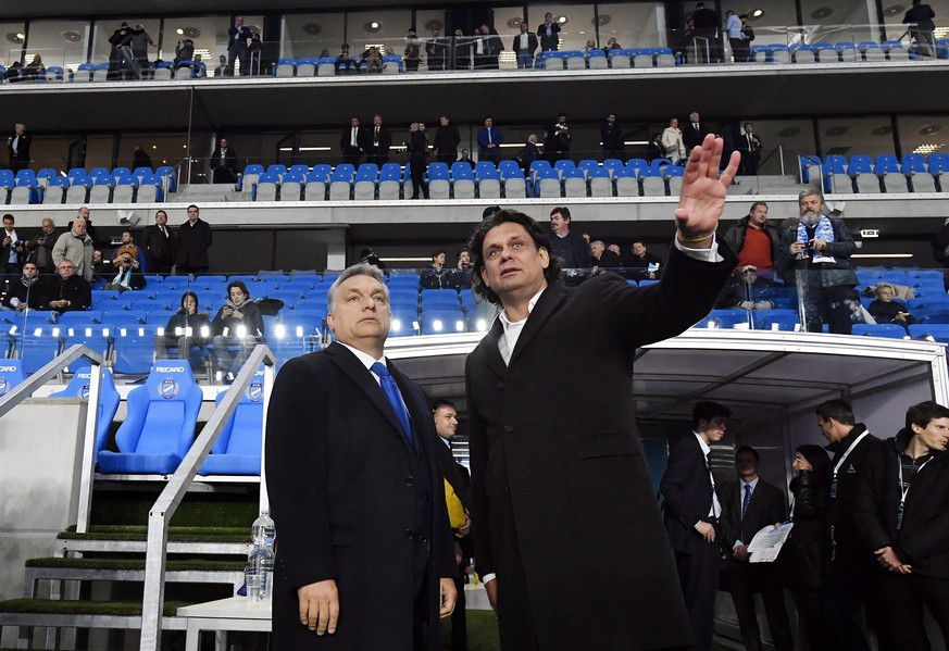 Hungarian Prime Minister Viktor Orban, left, and President of the Hungarian Soccer Club MTK Tamas Deutsch talk during the inauguration ceremony of MTK's new Hidegkuti Nandor Stadium, prior to the friendly soccer match of MTK Budapest and Sporting Lisboa of Portugal in Budapest, Hungary, Thursday, Oct. 13, 2016. The old venue was closed in May 2014 and construction works of the state-owned new arena began shortly after at the same site. (Tibor Illyes/MTI via AP)