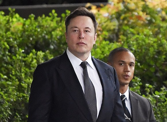 FILE - In this Wednesday, Dec. 4, 2019 file photo, Tesla CEO Elon Musk arrives at U.S. District Court in Los Angeles. Musk did not defame a British cave explorer when he called him â??pedo guyâ? in an angry tweet, a Los Angeles jury found Friday, Dec. 6, 2019. (AP Photo/Mark J. Terrill, File) Elon Musk