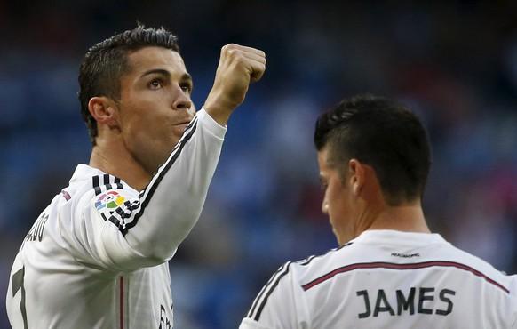 Real Madrid's Cristiano Ronaldo (L) celebrates his goal during their Spanish first division soccer match against Getafe at Santiago Bernabeu stadium in Madrid, Spain, May 23, 2015. REUTER/Juan Medina