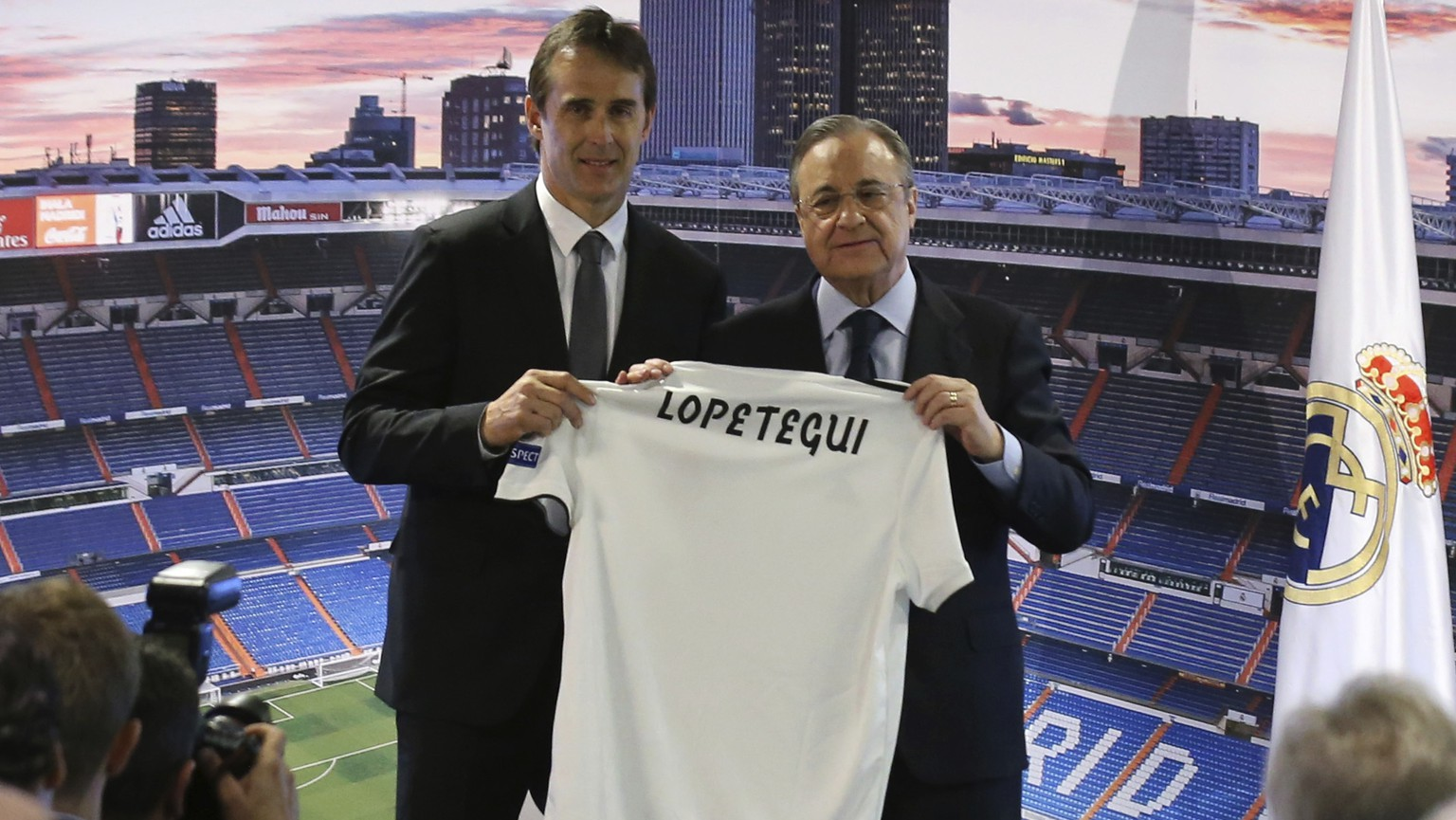 President of Real Madrid, Florentino Perez , centre right and newly appointed Real Madrid coach Julen Lopetegui pose for a photo, during a press conference in Madrid, Thursday, June 14, 2018. Lopetegui was the Spanish National team's coach but was fired on Wednesday, two days before Spain's opening match against Portugal, because he had accepted the job to coach Real Madrid next season. (AP Photo/Andrea Comas)