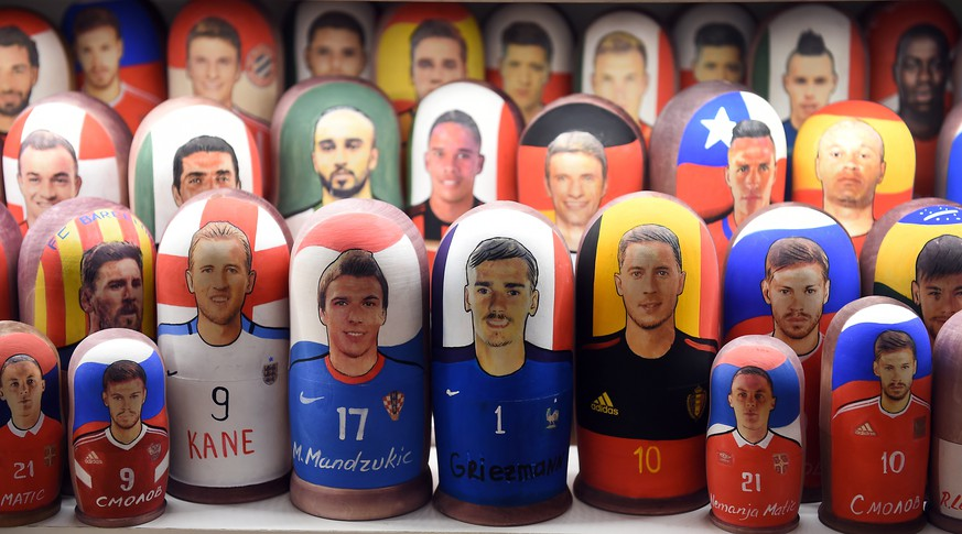 epa06885224 Matryoshka dolls depicting France's Antoine Griezmann (C-R) and Croatia's Mario Mandzukic (C-L) are on display in a souvenir shop in central Moscow, Russia, 13 July 2018. Croatia will face France in their FIFA World Cup 2018 final soccer match on 15 July.  EPA/FACUNDO ARRIZABALAGA