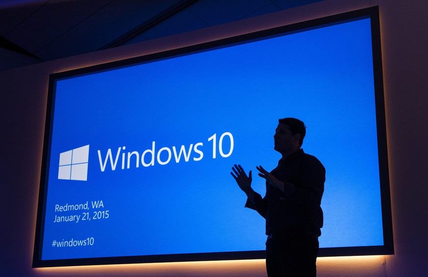epa04575678 Handout image released by Microsoft showing Microsoft Executive Vice President of Operating Systems Terry Myerson speaking during a Windows 10 press conference in Redmond, Washington, USA, 21 January 2015. Windows 10 will be offered as a free and perpetual upgrade within a year from Windows 7, 8.1 and Phone 8.1, a next-generation browser code-named 'Project Spartan', universal office and other apps and an Xbox app bringing gaming on Xbox Live to PCs.  EPA/MICROSOFT / HANDOUT  HANDOUT EDITORIAL USE ONLY/NO SALES
