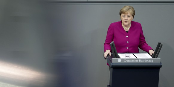 German Chancellor Angela Merkel delivers a speech during a meeting of the German federal parliament, Bundestag, at the Reichstag building in Berlin, Germany, Thursday, April 23, 2020. (AP Photo/Michael Sohn)