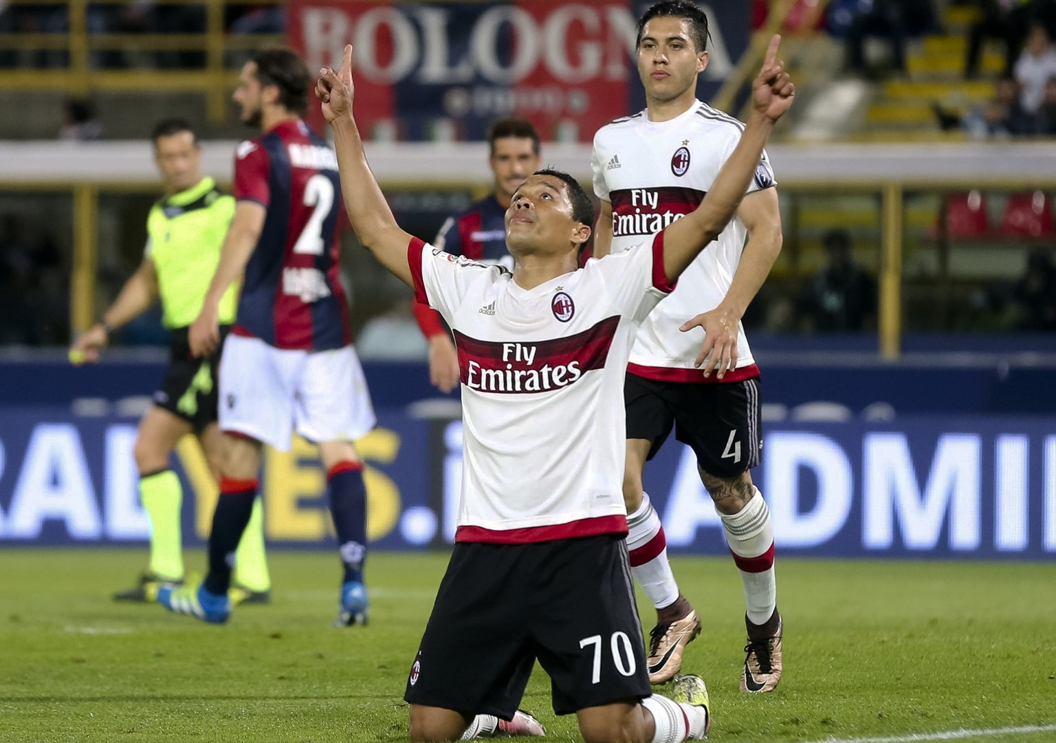 AC Milan's Carlos Bacca of Colombia, followed by teammate Jose Mauri of Argentina, jubilates after scoring on penalty during the Italian Serie A soccer match between Bologna FC and AC Milan at the Dall'Ara stadium in Bologna, Italy, Saturday, May 7, 2016. (Giorgio Benvenuti/ANSA via AP) ITALY OUT