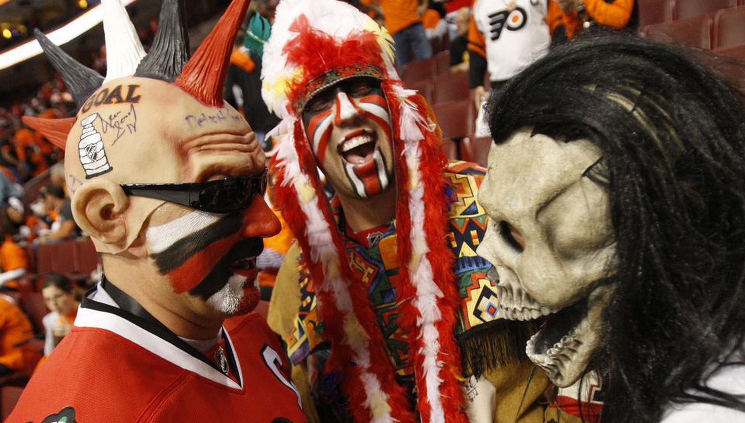 Philadelphia Flyers fan Chris Hamilton, right, talks with Chicago Blackhawks fans Jack Basich, left, of Portage, Ind., and Steve Desancic, center, of Munster, Ind., before Game 6 of the NHL Stanley Cup hockey finals Wednesday, June 9, 2010, in Philadelphia. (AP Photo/Kathy Willens)